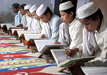 Children read the Koran at a madrasa