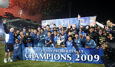 Members of the Deccan Chargers celebrate after winning the Indian Premier League trophy in 2009