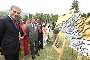 Pakistan's Foreign Minister Qureshi and his Indian counterpart SM Krishna attend an open art exhibition by SAARC artists themed 'Towards a Green and Happy South Asia' in Thimphu on Tuesday
