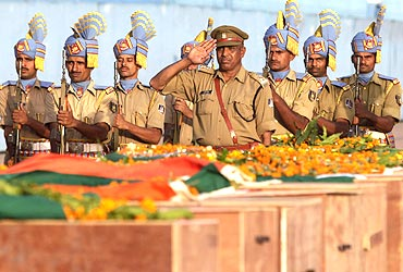 CRPF personnel pay their last respects to the policemen killed in the Dantewada massacre