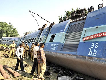 A train compartment which was derailed after Maoist rebels blew up a railway track in Jharkhand