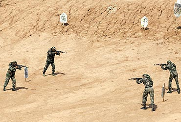 Security personnel train at a counter-terrorism and jungle warfare school in Kanker village in Chhattisgarh