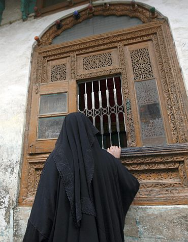 A Kashmiri woman prays at the Rozabal shrine in Srinagar. A decades-old theory that Jesus survived the crucifixion and spent his remaining years in Kashmir had drawn many people to Rozabal, a single-storey shrine with a traditional sloping roof located in a congested residential area of the capital Srinagar