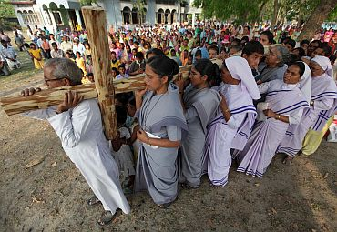 Christians carry a wooden cross outside a church on the occasion of Good Friday at Bagdogra on the outskirts of Siliguri in West Bangal on April 2, 2010.