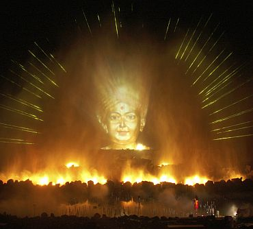 An image of a Hindu god is projected as part of the Sat-Chit-Anand water show with fires and fountains at Akshardham temple in Gandhinagar, Gujarat