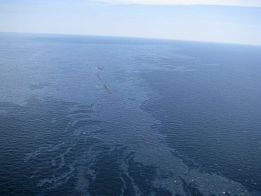 Debris and oil from the Deepwater Horizon drilling platform float in the Gulf of Mexico after the rig sank, off Louisiana on April 22