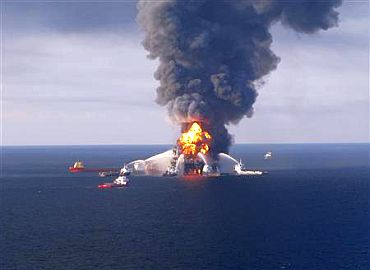 Fire boat response crews battle the blazing remnants of the off shore oil rig Deepwater Horizon, off Louisiana, in this handout photograph taken on April 21 and obtained on April 22