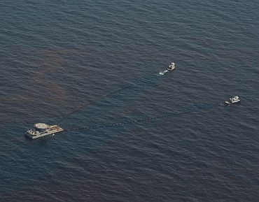 A High Volume Offshore Skimming System (VOSS) skims oil from the Gulf of Mexico