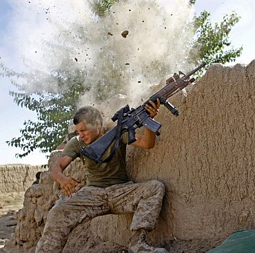 A US Army soldier barely misses being hit by a bullet during combat in Afghanistan