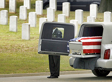 The casket containing the remains of Sergeant Jeffrey Kettle at the burial site in Virginia