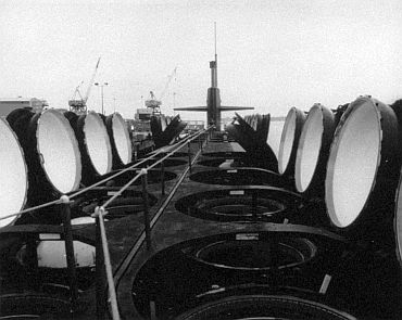 USS Ohio, strategic nuclear submarine of the US Navy. Commissioned in 1981, carries 24 Trident ballistic missiles in a double row of vertical launch tubes (shown with hatches open). The average patrol time at sea of Ohio-class submarines is 70 days, and their nuclear reactor cores need replacement only once every nine years.
