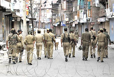 Police patrol a curfew-bound locality in Srinagar