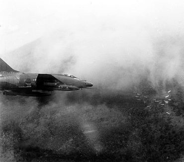 A US Air Force F-100 Super Sabre fires a salvo of rockets at a jungle target in Vietnam, May 1967