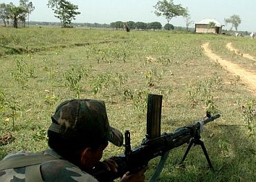 A paramilitary trooper on guard in a Naxal-hit Chhattisgarh village