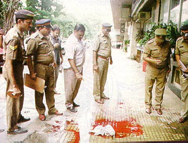 File picture of the Mumbai police inspecting an encounter site