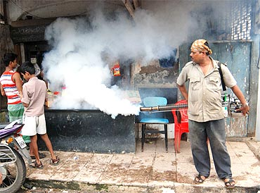 A municipal worker uses a fogging machine to combat rise in Malaria in Mumbai