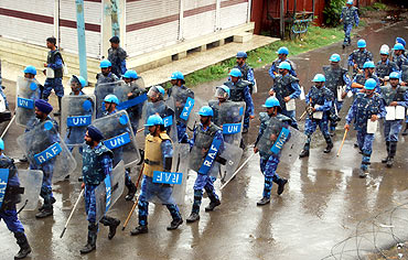 Rapid Action Force men parade through Srinagar streets.