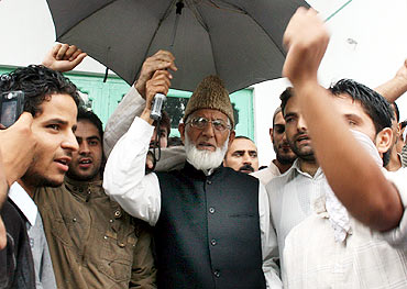 Separatist leader Syed Geelani with his aides in Srinagar