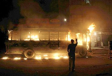 A bus torched by protestors in Karachi