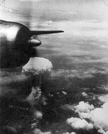 The Hiroshima mushroom cloud, through a window in one of the three B-29s, which went on the bombing run.