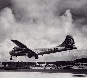 The Enola Gay lands at the island of Tinian after the bombing
