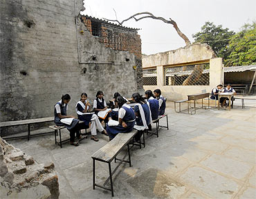 Schoolgirls study in a government-run school in Andhra Pradesh