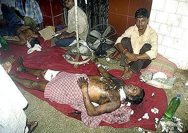 A patient rests on a hospital floor in  Agartala
