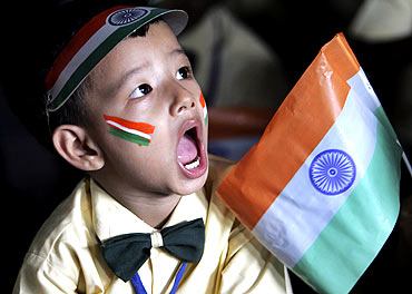 A boy attends Independence Day celebrations at a school