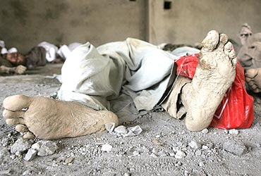 Bodies of flash flood victims lie inside a shop in Leh