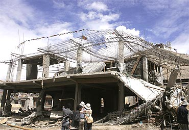 The rubble of houses destroyed by flash floods in Leh