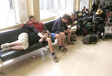 Stranded foreign tourists wait in Leh airport