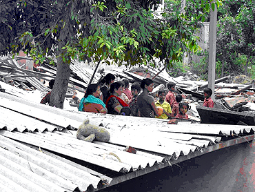 Teachers and students at the demolished school