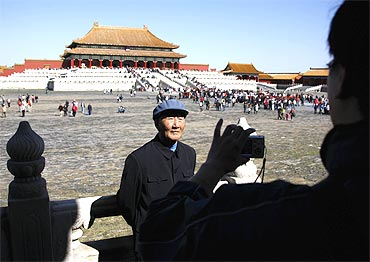 A Chinese man has his photograph taken at the Forbidden City in Beijing