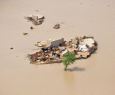 A family marooned by flood waters is seen from an Army helicopter in the Rajanpur district of Pakistan's Punjab province