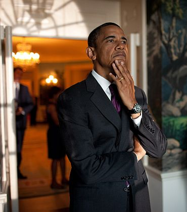 President Barack Obama waits in the Diplomatic Reception Room of the White House, prior to an event commemorating the 20th anniversary of the Americans with Disabilities Act on the South Lawn, July 26