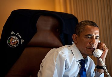President Obama talks on the phone with Palestinian Authority President Mahmoud Abbas aboard Air Force One