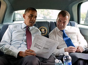 President Barack Obama and Russian President Dmitry Medvedev look at a Ray's Hell Burger menu during their ride to the restaurant in Arlington