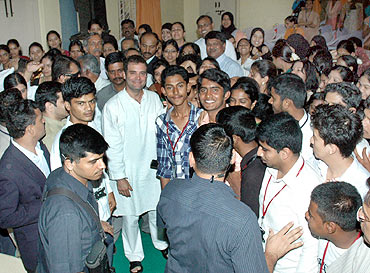 Rahul poses for a picture with the students