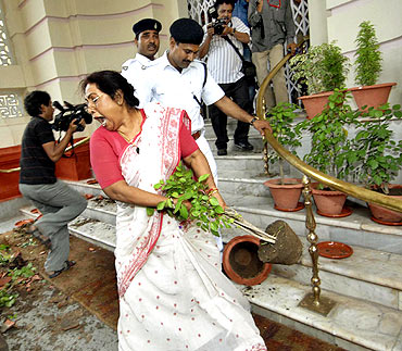 Politician Jyoti Devi breaks flower pots after she was expelled from the Bihar Legislative Assembly