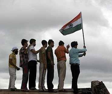 A man holds the Indian flag during independence day celebrations in Jammu