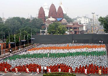 The Children in tricolor formation at the full dress rehearsal of the 64th Independence Day, at Red Fort, in Delhi on August 13, 2010
