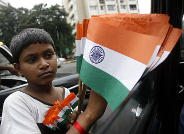 A boy sells national flags
