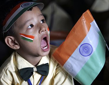 A boy attends Independence Day celebrations at a school in a slum area in Siliguri.