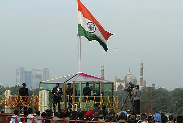 India's PM Singh addresses the nation during Independence Day celebrations in Delhi