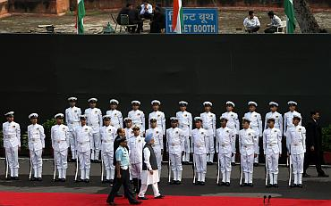 India's Prime Minister Manmohan Singh inspects a guard of honour at the Red Fort