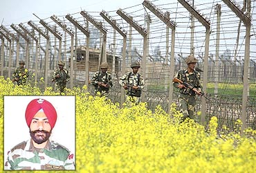 Inset:  Capt Devinder Singh Jass. Photo: Indian soldiers patrol the fenced border with Pakistan