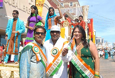 Dr. Sanjay Gupta President of Indo-US council , Grand Marshal Shivamani and Mrs Gupta at the Atlantic City India Day function