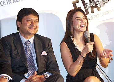Preity Zinta at the Federation of Indian Associations press conference in New York, with FIA chief Nirav Mehta