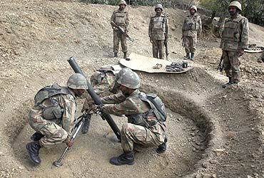 -Pakistani soldiers prepare to fire mortars towards Taliban militant positions in South Waziristan