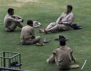 Cops take a break after patrolling duty in Srinagar